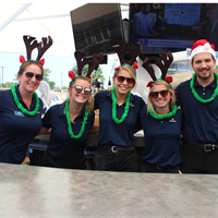 The pool bar staff shows their Christmas spirit during Christmas in July!